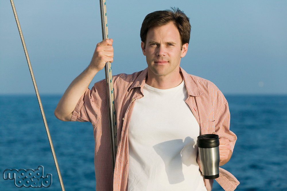 Man with Coffee Mug on Sailboat