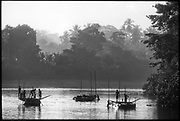 Sri Lanka.<br />These flat bottomed boats will be used to collect river sand. Men will go down to the bottom with cane baskets to collect the sand. It is brought to the shore and then sold to builders.