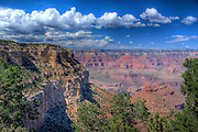 Dramatic cumulus clouds, red sandstone buttes. Grand Canyon National Park, Arizona