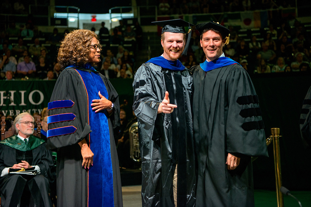Danny Twilley (Center) receives his Doctor of Philosophy from Dr. Peter Mather (Right) and Dean Renee Middleton (Left). Photo by Ben Siegel