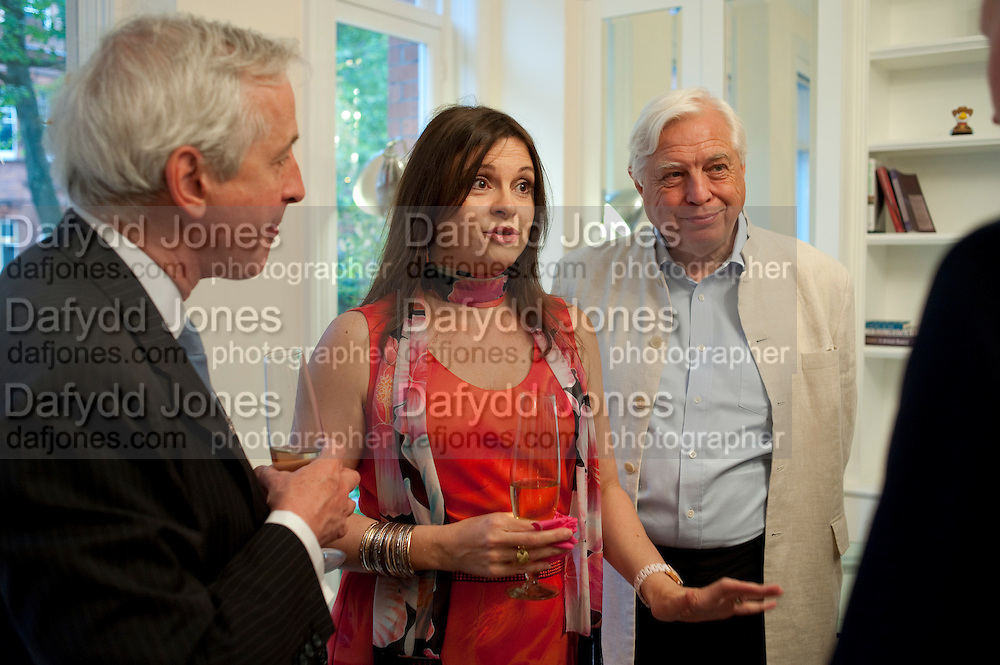 HUGO VICKERS; DEE SIMPSON; JOHN SIMPSON,  Party given by Basia and Richard Briggs at their home in Chelsea. London. 27 April 2011. <br /> <br />  , -DO NOT ARCHIVE-© Copyright Photograph by Dafydd Jones. 248 Clapham Rd. London SW9 0PZ. Tel 0207 820 0771. www.dafjones.com.