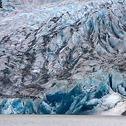 Mendenhall Glacier is a glacier about 12 miles (19 km) long located in Mendenhall Valley, about 12 miles (19 km) from downtown Juneau, Alaska. The glacier and surrounding landscape is protected as the 5,815-acre Mendenhall Glacier Recreation Area.<br /> Photography by Jose More