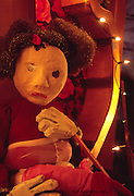 Broken hearted mother marionette puppet sitting with hand on heart mourning the loss of her daughter, Spain