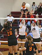 Maquoketa's Allison Vandemore (5) and Devon OConnell (20) try to block a shot by Solon's Vik Meade (28) during the WaMaC Tournament Championship game at Mount Vernon High School in Mount Vernon on Thursday October 11, 2012. Solon defeated Maquoketa 17-25, 25-15, 15-10.