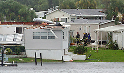 Palm Bay firefighters go house to house after a possible tornado touched down at Palm Bay Estates on Sunday, September 10, 2017 as Hurricane Irma made landfall in the state of Florida. Photo by Red Huber/Orlando Sentinel/TNS/ABACAPRESS.COM