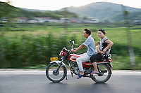 Family  on a motorcycle in Anji China 2009.