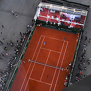 30.05.2018  Roland-Garros Tennis visits The Eiffel Tower in Paris France for a special legends exhibition doubles event on a court built beneath of the four legs of the Eiffel tower featuring John MeEnroe, Mansour Bahrami, Sergi Bruguera and Cedric Pioline Overhead view