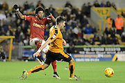 Nottingham Forest striker Ryan Mendes flicks the ball past Wolverhampton Wanderers defender Danny Batth during the Sky Bet Championship match between Wolverhampton Wanderers and Nottingham Forest at Molineux, Wolverhampton, England on 11 December 2015. Photo by Alan Franklin.