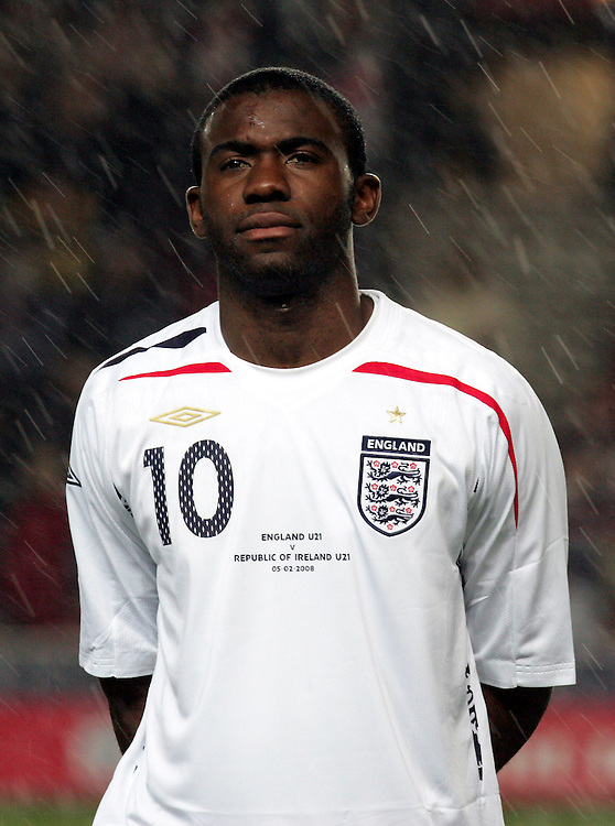 Fabrice Muamba lines up in the rain for the national anthem before the game. England v Republic of Ireland, Uefa Under-21 Championship Qualifier, Tuesday 5th February 2008, St Marys, Southampton.