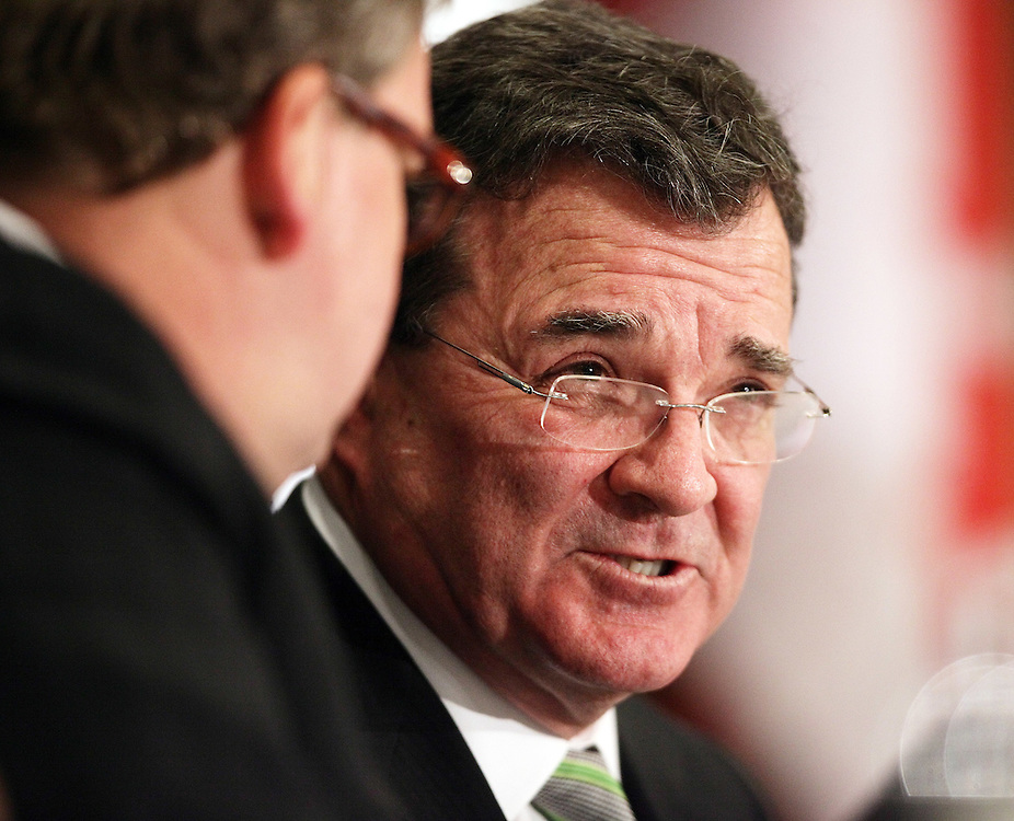 Finance Minister Jim Flaherty speaks to London West MP Ed Holder following the minister's speech to the London Chamber of Commerce in London, Ontario, March 5, 2010. <br /> REUTERS/Geoff Robins (CANADA/)