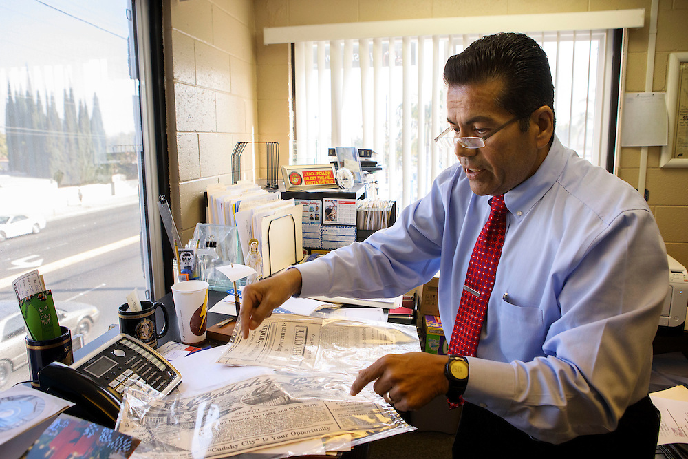 George Perez, president and chief executive officer of Tract 180 Water Tract Co. and former city manager looks though old newspaper clippings from the early days of Cudahy history on Wednesday, December 14, 2016 in Cudahy, Calif. © 2016 Patrick T. Fallon