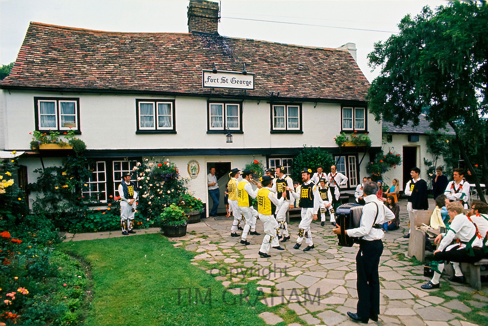 Morris dancers at traditional annual festival at the Fort St George Pub in Cambridge, England, UK