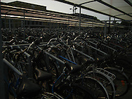 Bicycles at Bruges train station, Belgium.