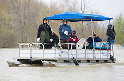 A pontoon boat used to transport residents to and from their flooded homes moves along the Rigaud River near the town of Rigaud, Quebec, Canada., west of Montreal, Monday, May 8, 2017, following flooding in the region. Photo by Graham Hughes /The Canadian Press/ABACAPRESS.COM