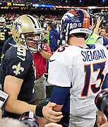 NEW ORLEANS, LA - NOVEMBER 13:  Drew Brees #9 of the New Orleans Saints congratulates Trevor Siemian #13 of the Denver Broncos at Mercedes-Benz Superdome on November 13, 2016 in New Orleans, Louisiana.  The Broncos defeated the Saints 25-23.  (Photo by Wesley Hitt/Getty Images) *** Local Caption *** Drew Brees; Trevor Siemian