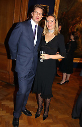 IVO & PANDORA CURWEN at a reception hosted by Brian Ivory Chairman of the Trustees of The National Galleries of Scotland to commemorate Sir Timothy Clifford's 21 years of Director of the National Gallery of Scotland and his forthcoming retirement in January 2006, held at Christie's, King Street, London W1 on 6th December 2005.<br />