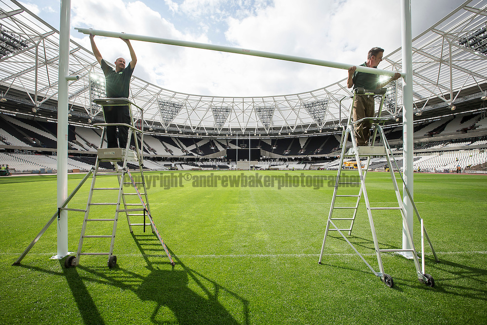 LONDON UK. 21st Aug 2015.<br /> 2015 Rugby World Cup goal posts installed.<br /> Peter Spence and Steve Heap install the final cross bar of the goal post for the rugby pitch, in preparation for the friendly between the Barbarians and Samoa on the 29th August at the former Olympic Stadium.<br /> <br /> Photo credit : Andrew Baker<br /> 07977074356