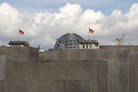 "09 MAY 2005, BERLIN/GERMANY:<br /> Die Reichstagskuppel, Flaggen und die Quadriga, hinter dem Denkmal fuer die ermordeten Juden Europas, einen Tag vor der Eröffnung, bei bewölktem Himmel<br /> The Reichstag and the Quadriga behind the new memorial to the millions of Jews killed by the Nazis the ""Memorial to the murdered Jews of Europe"", on day before the official opening in central Berlin <br /> IMAGE: 20050509-03-005<br /> KEYWORDS: Denkmal für die ermordeten Juden Europas; Holocaust Mahnmal"