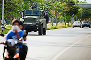 """Sept 26, 2009 -- PATTANI, THAILAND: A Thai army armored car patrols the main highway between the provincial capitols of Pattani and Narathiwat Saturday, Sept. 26. Thailand's three southern most provinces; Yala, Pattani and Narathiwat are often called """"restive"""" and a decades long Muslim insurgency has gained traction recently. Nearly 4,000 people have been killed since 2004. The three southern provinces are under emergency control and there are more than 60,000 Thai military, police and paramilitary militia forces trying to keep the peace battling insurgents who favor car bombs and assassination.   Photo by Jack Kurtz"""