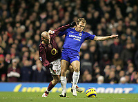 Photo: Lee Earle.<br /> Arsenal v Chelsea. The Barclays Premiership. 18/12/2005. Arsenal's Fredrik Ljungberg (L) battles with Arjen Robben.