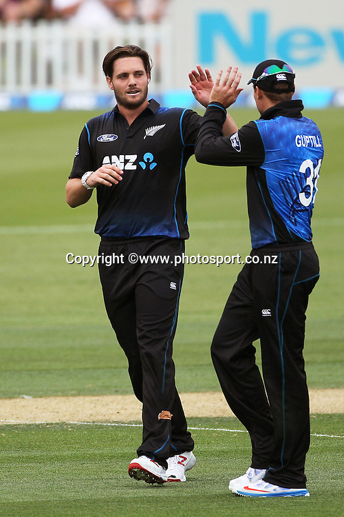 Mitchell McClenaghan of the Black Caps is congratulated by Martin Guptill during the first ODI between the Black Caps v Sri Lanka at Hagley Oval, Christchurch. 11 January 2015 Photo: Joseph Johnson / www.photosport.co.nz