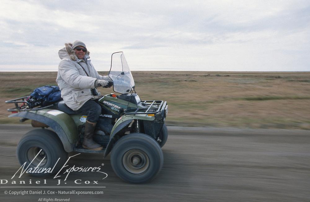 Denver Holt in the field checking for Snowy Owl nest sites. Barrow, Alaska