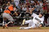 PHOENIX, AZ - AUGUST 15:  A.J. Pollock #11 of the Arizona Diamondbacks safely slides home to score in front of Max Stassi #12 of the Houston Astros in the fifth inning at Chase Field on August 15, 2017 in Phoenix, Arizona.  (Photo by Jennifer Stewart/Getty Images)