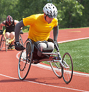 West Point, New York - Army's Matthew Spang leads in the wheelchair 1,500-meter race at the 2014 Army Warrior Trials at the United States Military Academy Preparatory School on Tuesday, June 17, 2014.<br />