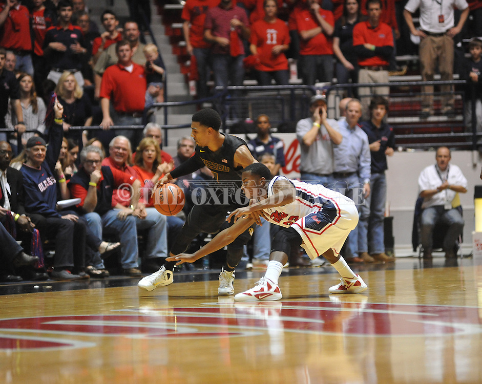"Missouri's Phil Pressey (1) vs. Ole Miss' Jarvis Summers (32) at the C.M. ""Tad"" Smith Coliseum on Saturday, January 12, 2013. Ole Miss defeated #10 ranked Missouri 64-49."