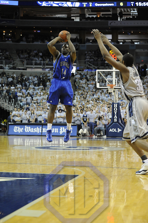 02 February 2008:   Seton Hall Pirates forward Brian Laing (14) scores against Georgetown University Hoyas forward Patrick Ewing (33) at the Verizon Center in Washington, D.C.  The Hoyas defeated the Seton Hall Pirates 73-61.