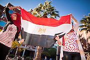 31 JANUARY 2011 - TEMPE, AZ: AYAH AHMED, left, and AMANDA ELGAMAL, both Egyptian-Americans, wave an Egyptian flag in downtown Tempe Monday. About 200 people marched through central Tempe, AZ, near the Arizona State University campus Monday afternoon. The rally was organized by the Arab American Association of Arizona in solidarity with the ongoing pro-democracy rallies and demonstrations in Egypt and other Arab countries.    Photo by Jack Kurtz