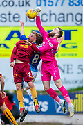 Zander Clark (#1) of St Johnstone FC punches the ball clear ahead of Richard Tait (#2) of Motherwell FC during the Ladbrokes Scottish Premiership match between St Johnstone and Motherwell at McDiarmid Stadium, Perth, Scotland on 11 May 2019.