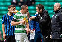 05/10/14 SCOTTISH PREMIERSHIP<br /> CELITC v HAMILTON<br /> CELTIC PARK - GLASGOW<br /> Celtic manager Ronny Deila (2nd from right) talks tactics with Captain Scott Brown