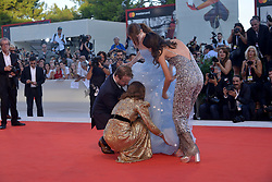 75th Venice Film Festival - Vox Lux Red Carpet Arrivals - Natalie Portman. 04 Sep 2018 Pictured: Director Brady Corbet, actress Natalie Portman and actress Stacy Martin assist actress Raffey Cassidy (C) with her dress. Photo credit: KILPIN / MEGA TheMegaAgency.com +1 888 505 6342