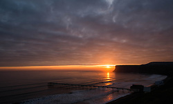 © Licensed to London News Pictures. <br /> 05/04/2015. <br /> <br /> Saltburn, United Kingdom<br /> <br /> The sun rises over the horizon on Easter Sunday in Saltburn, United Kingdom.<br /> <br /> Photo credit : Ian Forsyth/LNP
