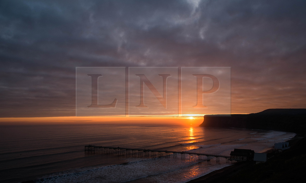 &copy; Licensed to London News Pictures. <br /> 05/04/2015. <br /> <br /> Saltburn, United Kingdom<br /> <br /> The sun rises over the horizon on Easter Sunday in Saltburn, United Kingdom.<br /> <br /> Photo credit : Ian Forsyth/LNP
