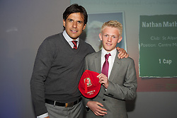 CARDIFF, WALES - Saturday, May 11, 2013: Nathan Mathias is presented with his U16's cap by Wales national team manager Chris Coleman at the FAW Trust Under-16's cap presentation. (Pic by David Rawcliffe/Propaganda)
