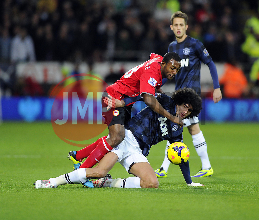 Cardiff City Midfielder, Kevin Theophile Catherine (FRA) is fouled by Man Utd Midfielder Marouane Fellaini (BEL) - Photo mandatory by-line: Joseph Meredith/JMP - Tel: Mobile: 07966 386802 - 24/11/2013 - SPORT - FOOTBALL - Cardiff City Stadium - Cardiff City v Manchester United - Barclays Premier League.