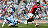 Photo: Paul Thomas.<br /> Manchester City v Manchester United. The Barclays Premiership. 05/05/2007.<br /> <br /> Michael Ball (L) of City fouls Cristiano Ronaldo.