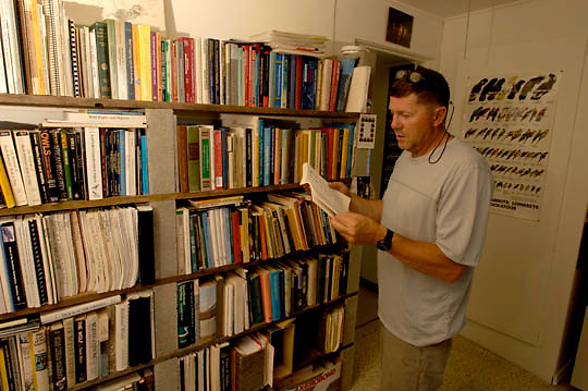 Denver Holt, Coordinator of the Owl Institute in Charlo, Montana in research library at the facilities.