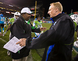 November 19, 2009; San Francisco, CA, USA;  California Redwoods head coach Dennis Green and Florida Tuskers head coach Jim Haslett meet after the game at AT&T Park. Florida defeated California 34-27.