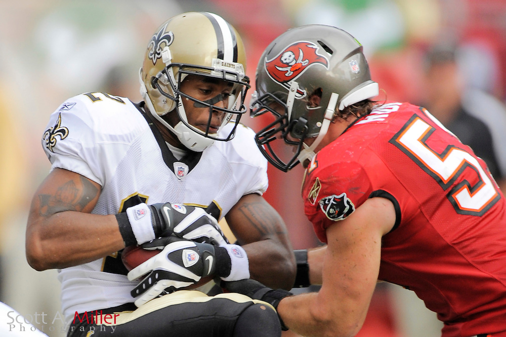 Nov. 22, 2009; Tampa, FL, USA; New Orleans Saints wide receiver Marques Colston (12) is tackled by Tampa Bay Buccaneers linebacker Barrett Ruud (51)during their game at Raymond James Stadium. ©2009 Scott A. Miller.© 2009 Scott A. Miller