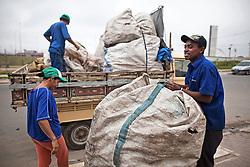 Catadores from Cooperativa Nova Esperança collecting at the neighborhood...workers: Marcos Alexandre dos Santos and Edinalva Novais.