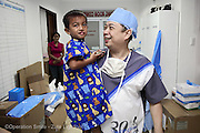 Anesthesiologist Paulito Demapelis from the Philippines takes a patient to surgery.<br />  Isabel United Doctor Medical Centre. Operation Smile's 2015 mission to Cauayan city. Philippines. 14th -21st February 2015.<br /> <br /> (Operation Smile Photo - Zute Lightfoot)