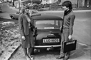 Mrs Parsloe and Mark next to a car, High Wycombe, UK, 1980s.
