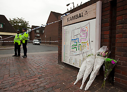 © Licensed to London News Pictures. 19/09/2013. London, UK. Flowers and police officers are seen at a cordon surrounding the site of a shooting on Coppock Close in Battersea London today (19/09/2013). Taking place at around 8pm last night a 19 year old male was pronounced dead at around 9pm. Photo credit: Matt Cetti-Roberts/LNP