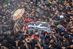 May 24, 2019, Pulwama, Jammu and Kashmir, India - (EDITORS NOTE: Image depicts death) Kashmiri villagers are seen carrying a dead body of the Militant commander Zakir Musa during his funeral at his residence in Pulwama, South of Kashmir. Zakir Rashid Bhat Alias Musa was killed late on Thursday by the security forces in Pulwama district when security forces had launched a cordon and search operation in Dadsara village of Tral area, South of Srinagar following information about militant presence. (Credit Image: © Idrees Abbas/SOPA Images via ZUMA Wire)