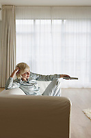 Young Woman Using Television Remote Control