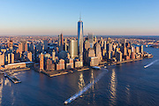 Aerial view of Battery Park City at sunset showing One World Trade Center, photographed from a helicopter.