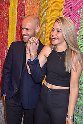 Cameron Saul and Amber Joseph at a cocktail supper hosted by BOTTLETOP co-founders Cameron Saul & Oliver Wayman, along with Arizona Muse, Richard Curtis & Livia Firth to launch the #TOGETHERBAND campaign at The Quadrant Arcade on April 24, 2019 in London, England.<br /> <br /> ***For fees please contact us prior to publication***